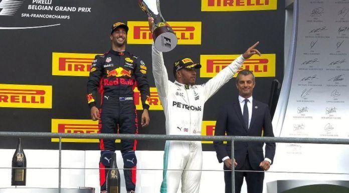 Lewis Hamilton menjuarai balapan F1 GP Belgia setelah mememangi persaingan ketat melawan Sebastian Vettel di Sirkuit Spa-Franchorcamps, Minggu (27/8). (F1)