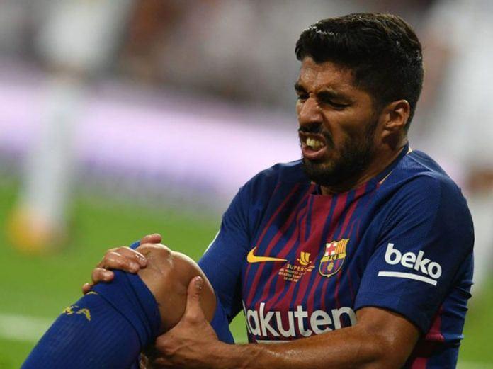 Foto: Luis Suarez harus absen selama satu bulan dan membuat Barcelona berada dalam kesulitan besar.
