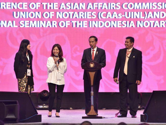 Foto: Presiden Jokowi saat menghadiri Seminar Internasional Ikatan Notaris Indonesia, di Bali Nusa Dua Convention Center, Bali, Jumat (8/9).