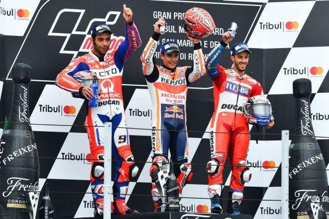 Podium juara MotoGP San Marino ditempati oleh Marc Marquez, Danilo Petrucci dan Andrea Dovizioso. (AFP PHOTO / ANDREAS SOLARO)