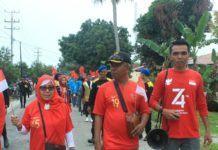 Jalan Sehat Kuala Tanjung, IPKTB dan Pemdes Tampil dengan Jiwa Patriotis