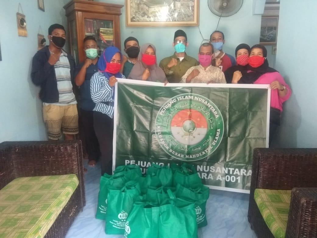 Pejuang Islam Nusantara Sumut, Menyalurkan Bantuan dari Kapolda kepada Masyarakat Terdampak Covid-19