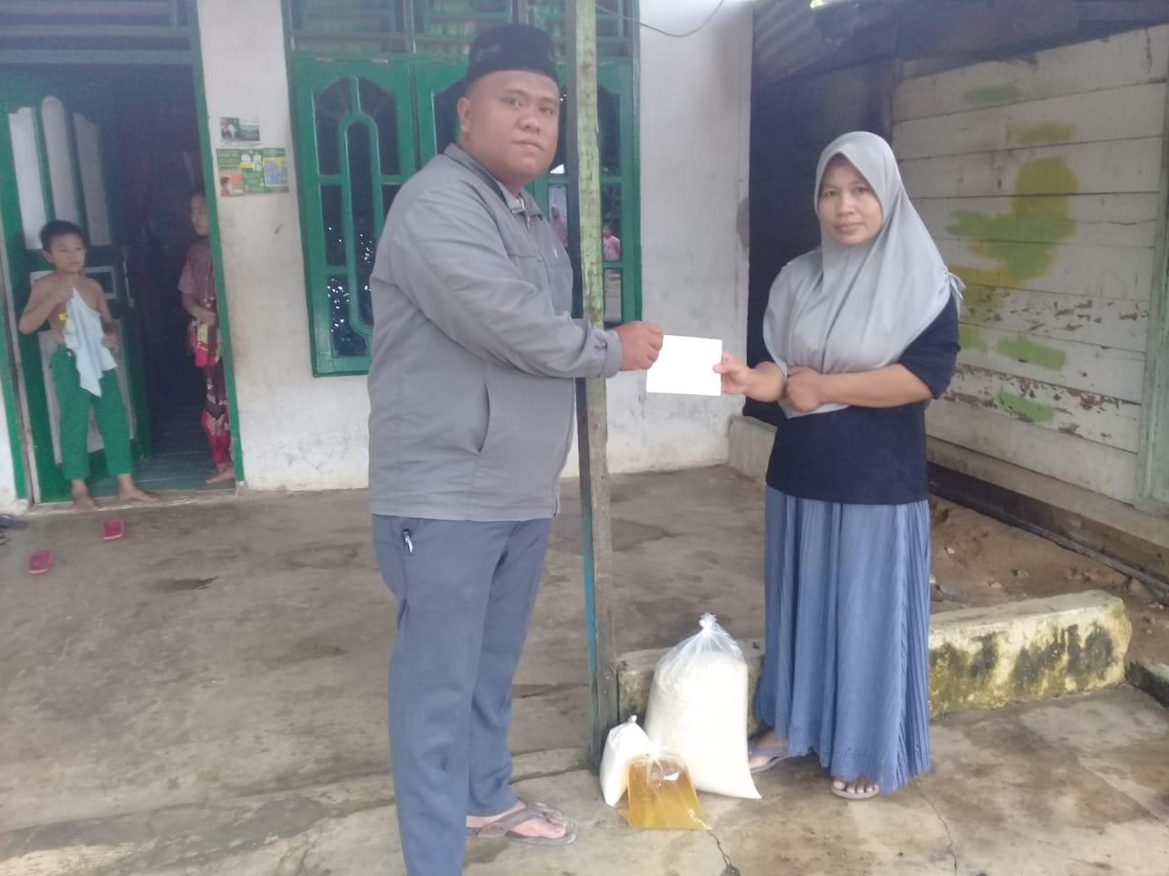 Pejuang Islam Nusantara Labuhanbatu Raya Salurkan Bantuan, Berbagi Masker dan Stiker