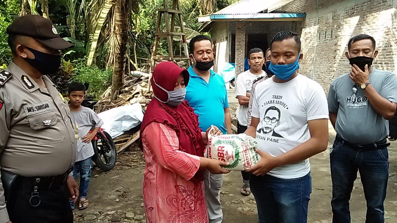 Berbagi Sembako, HMI Sumut dan Polres Asahan Sasar Desa Pulau Rakyat Tua