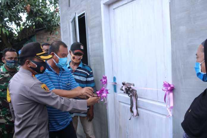 Kapolres Sergai, Resmikan 2 Unit Rumah Warga yang Terdampak Bencana Puting Beliung