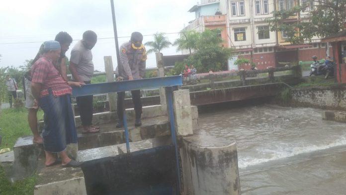 Banjir Seputaran Perbaungan, Kapolres Sergai Tinjau Bendungan Pintu DAM Sungai Baungan